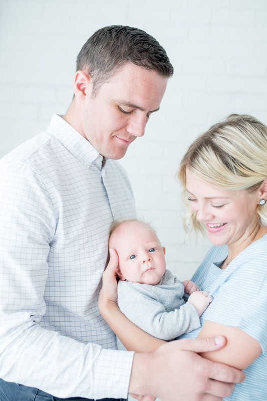 Bright and airy natural light studio lifestyle newborn session by Flying Gull Photography