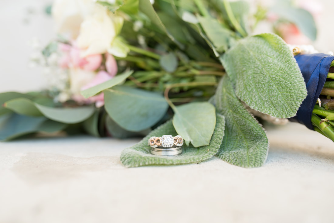 Wedding rings resting on bouquet with lamb's ear Manti, Utah wedding photographer Flying Gull Photography