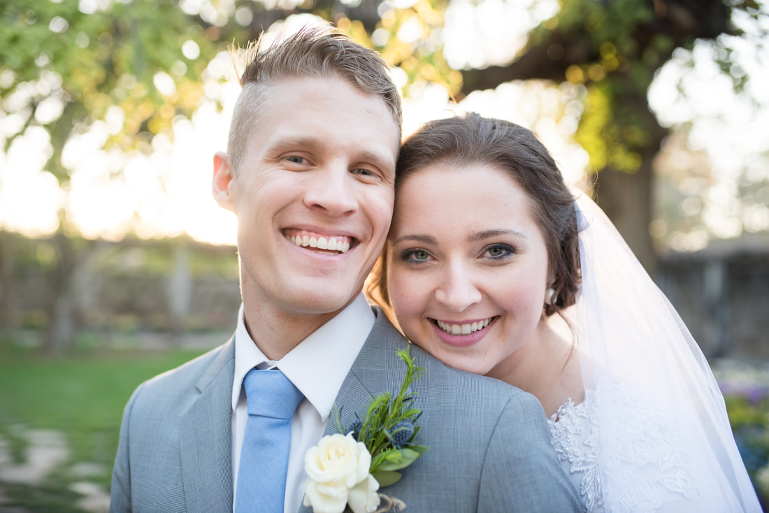 Smiling portrait of bride and groom