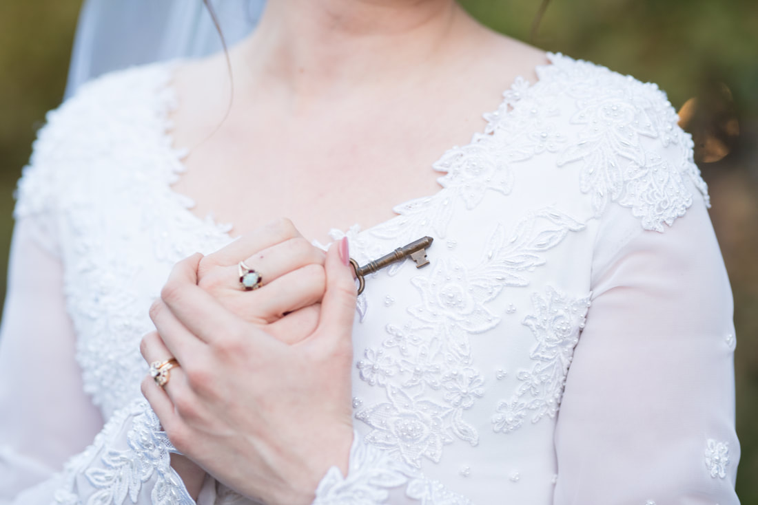 Bride holding key to her heart