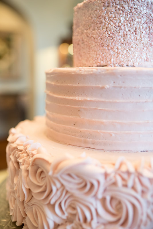 Pink frosted wedding cake