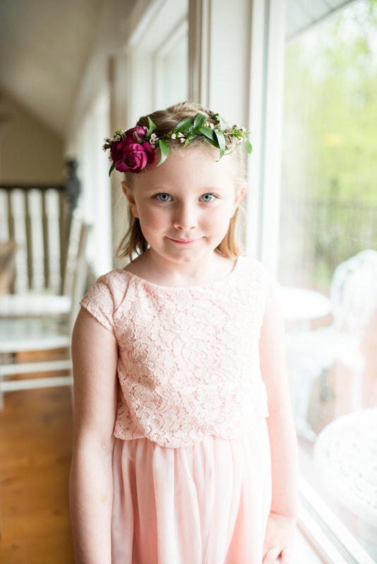 Flower girl in pink dress with floral crown