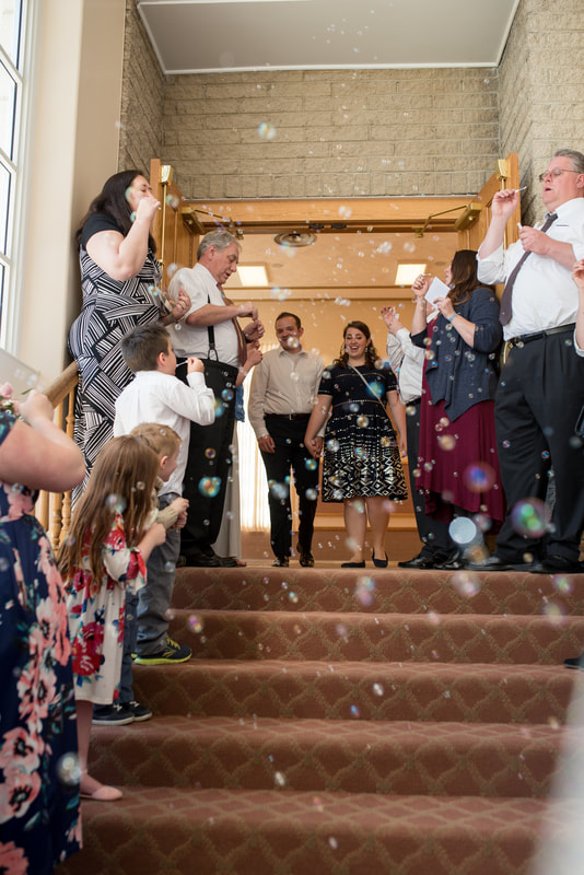 couple exiting reception with bubble send-off Manti, Utah wedding photographer Flying Gull Photography